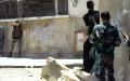 الصورة: الصورة: الجيش الحر يقطع ذراع الأسد الأمنية