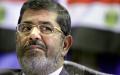 الصورة: الصورة: مرسي يهدد بالإضراب عن الطعام ويطلب لقاء الشاطر