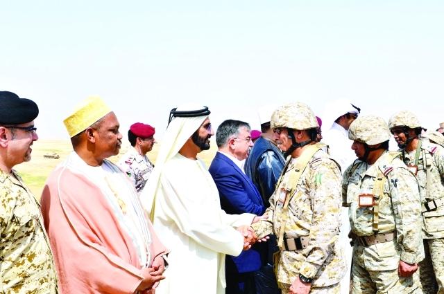 نائب رئيس الدولة مصافحاً قادة عسكريين | تصوير: سيف محمد