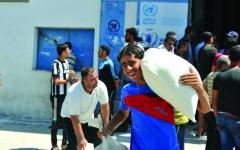 الصورة: الصورة: مساعدات «الأونروا» للاجئين الفلسطينيين إلكترونياً