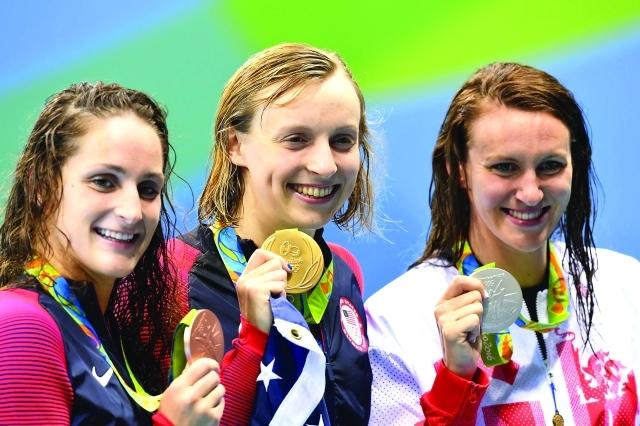 الصورة : ■ سيدات أميركا يسيطرن على منافسات السباحة    أ ف ب
