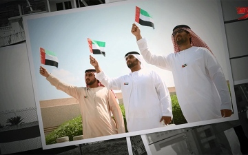 الصورة: قلوب أهل الإمارات تردد: دام الأمان وعاش العلم يا إماراتنا