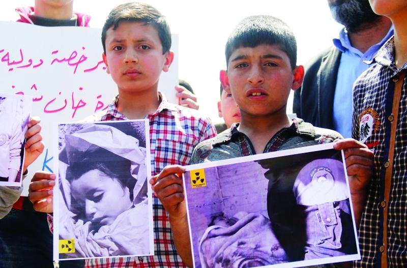 Ⅶ  أطفال في بلدة خان شيخون ينددون بالهجوم الكيماوي |   أ.ف.ب