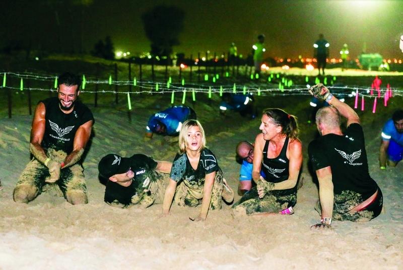■  عائلة «ريو» تتحدى إعاقة ابنها وتشارك في السباق