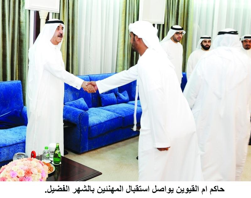 الصورة : ■ سعود المعلا وراشد بن سعود خلال استقبال المهنئين