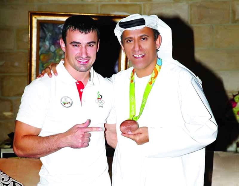 ■ بن ثعلوب مع البطل الأولمبي توما
