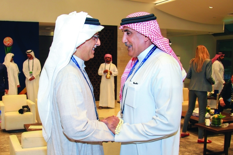الصورة : .. مع سلمان بن إبراهيم رئيس الاتحاد الآسيوي  |  البيان