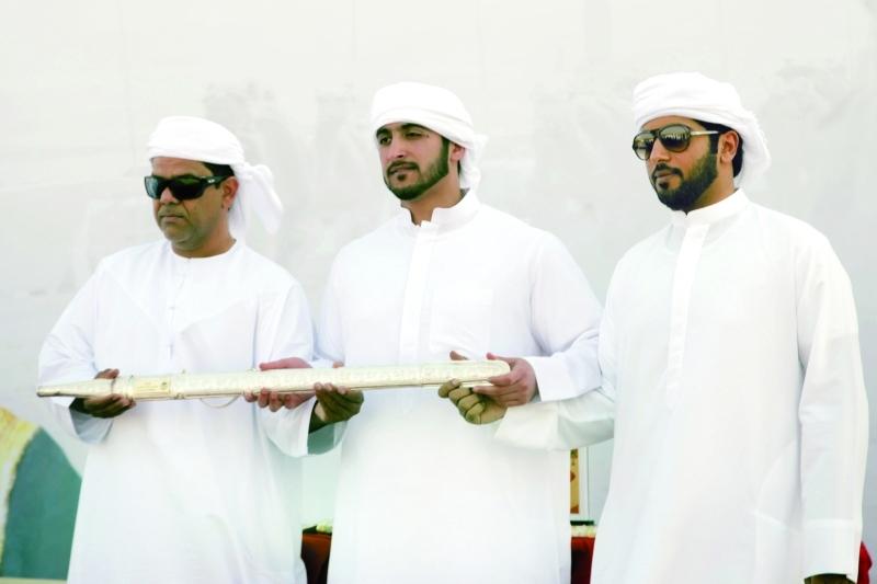 الصورة : مكتوم بن حمدان آل مكتوم خلال تتويج الفائزين