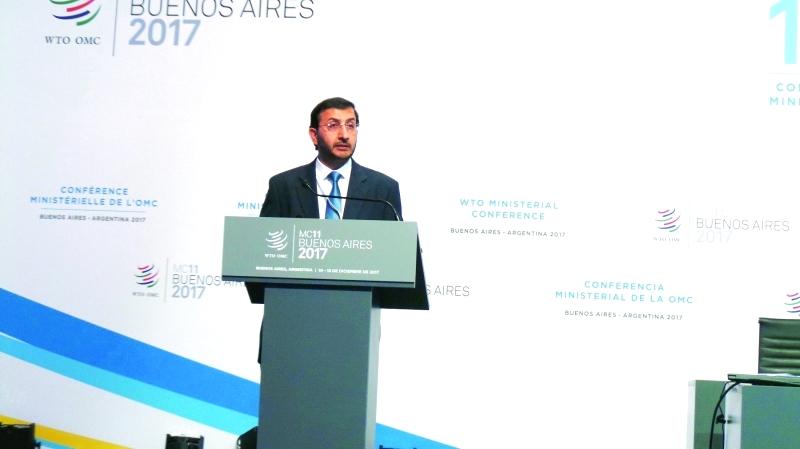 الصورة : Ⅶ عبدالله آل صالح خلال كلمته أمام مؤتمر منظمة التجارة   |  من المصدر