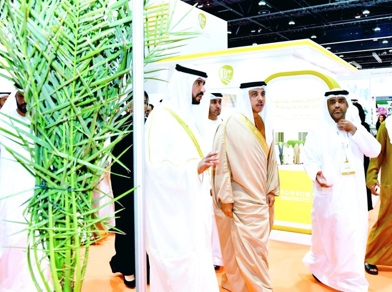 الصورة : ■ منصور بن زايد خلال افتتاح المعرض     وام
