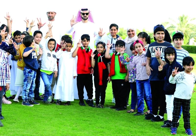 الصورة : ■   لقطة جماعية مع الأطفال المشاركين  |  البيان