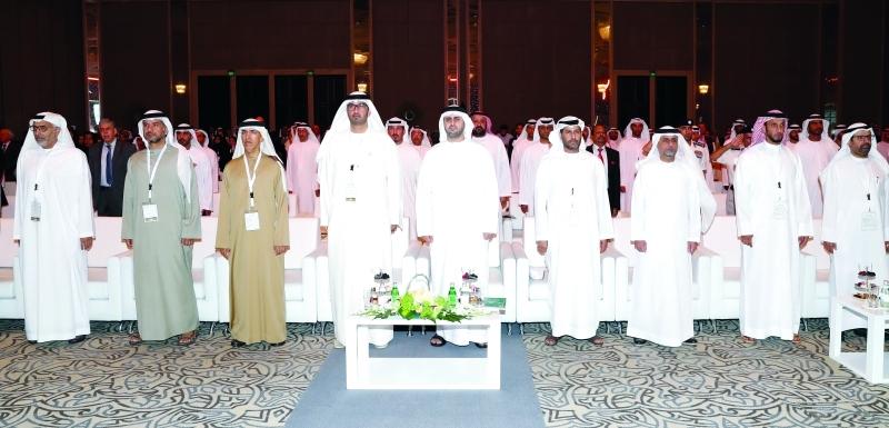 الصورة : ذياب بن محمد بن زايد خلال الجلسة الافتتاحية للملتقى بحضور سلطان الجابر وكبار المسؤولين  |  وام