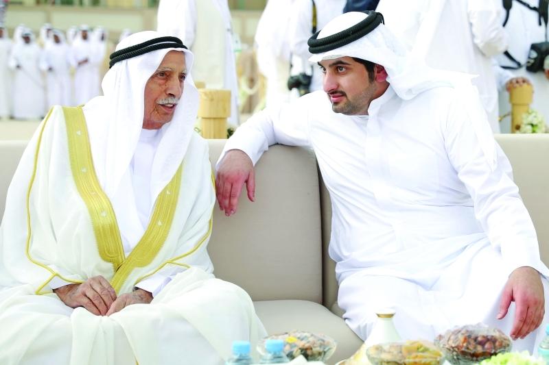 أحمد بن محمد وجمعة الماجد خلال الحفل