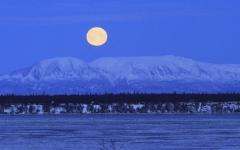 الصورة: صور .. كيف بدا القمر الأزرق العملاق حول العالم؟