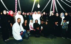 الصورة: موظفو «صحة دبي» وأسرهم في «عزبتنا غير»