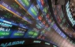 الصورة: الأسهم الأميركية تغلق متباينة بعد جلسة متقلبة