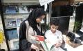 الصورة: سلوى آل رحمة.. هزمت السرطان بالضربة القاضية