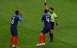 الصورة: محمد عبد الله يدير مباراة فرنسا وبيرو في مونديال 2018