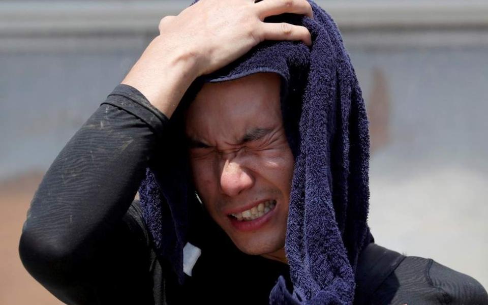الصورة: الحرارة تقتل 15 شخصا في اليابان