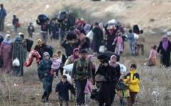 الصورة: مئات اللاجئين السوريين يغادرون لبنان إلى بلادهم