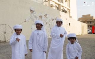 الصورة: هل تعرفون من هم الأطفال السبعة المصورون على جدارية في دبي؟