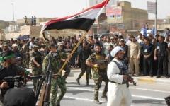 الصورة: «الحشد» يستولي على مؤسسات حكومية في العراق بقوة السلاح