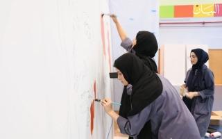 """الصورة: في حب زايد.. """"اليدار"""" 140 متراً بأنامل 22 طالبة مبدعة"""