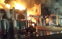 الصورة: إخماد حريق بمنشأة نجارة  في صناعية العين