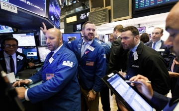 الصورة: الأسهم العالمية تحلّق ومستويات قياسية في «وول ستريت»