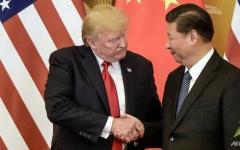 """الصورة: بكين تعمل على """"نقاط التوافق"""" التي توصلت إليها مع واشنطن"""