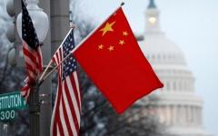 الصورة: الصين تعلق الرسوم الجمركية على السيارات الأميركية