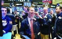 الصورة: انتعاش الأسواق العالمية وسط توقعات بإطفاء نيران الحرب التجارية