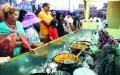 الصورة: الصورة: القرية العالمية.. أكبر مائدة متنوعة مفتوحة في العالم