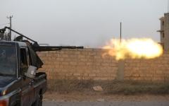 الصورة: الصورة: الميليشيات تزج بالمهاجرين ضد الجيش الليبي