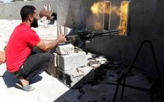 الصورة: الصورة: تعزيزات تدعم الجيش الليبي  على مشارف طرابلس