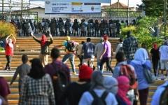 الصورة: الصورة: خمسة جرحى بإطلاق قوات الأمن النار على متظاهرين من الطلاب في هندوراس