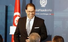 الصورة: الصورة: رئيس الحكومة التونسية يفوض مهامه لوزير الوظيفة العمومية