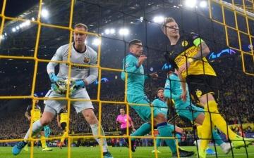 الصورة: الصورة: دورتموند غير المحظوظ يتعادل مع برشلونة في عودة ميسي