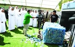الصورة: الصورة: أصحاب الهمم يحمون البيئة بإعادة تدوير العبوات البلاستيكية