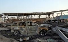 الصورة: الصورة: مقتل 12 مدنياً بانفجار عبوة ناسفة في حافلة بكربلاء