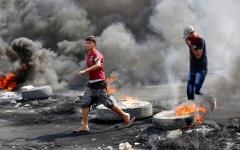 الصورة: الصورة: تظاهرات العراق.. دخان لا يحجب الرؤية