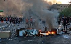 الصورة: الصورة: احتجاجات العراق تكسر حظر التجوال