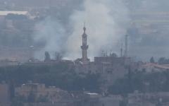 الصورة: الصورة: قصف على رأس العين بعد ساعات من اتفاق أمريكي - تركي على وقف إطلاق النار