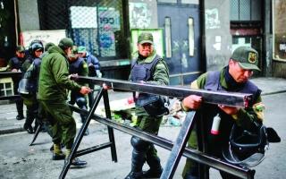 الصورة: الصورة: موراليس يلجأ للمكسيك والجيش يتعهد بوقف العنف