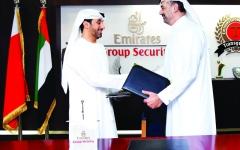 الصورة: الصورة: توسيع الشراكة بين أمن مجموعة الإمارات والمعهد الأمني الوطني