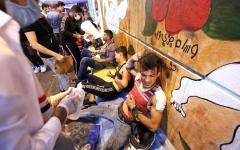 الصورة: الصورة: مقتل 4 متظاهرين بانفجار سيارة وسط بغداد