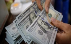 الصورة: الصورة: الدولار يرتفع بعد تدهور العلاقات الأمريكية الصينية