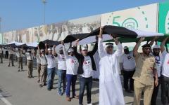 الصورة: الصورة: علم الإمارات يدخل غينيس كأطول علم في العالم
