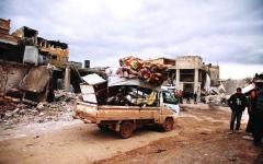 الصورة: الصورة: الدولار يقسم سوريا.. وينذر بكارثة اقتصادية