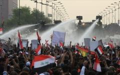 الصورة: الصورة: إصابة 7 محتجين في مصادمات مع الشرطة بوسط بغداد